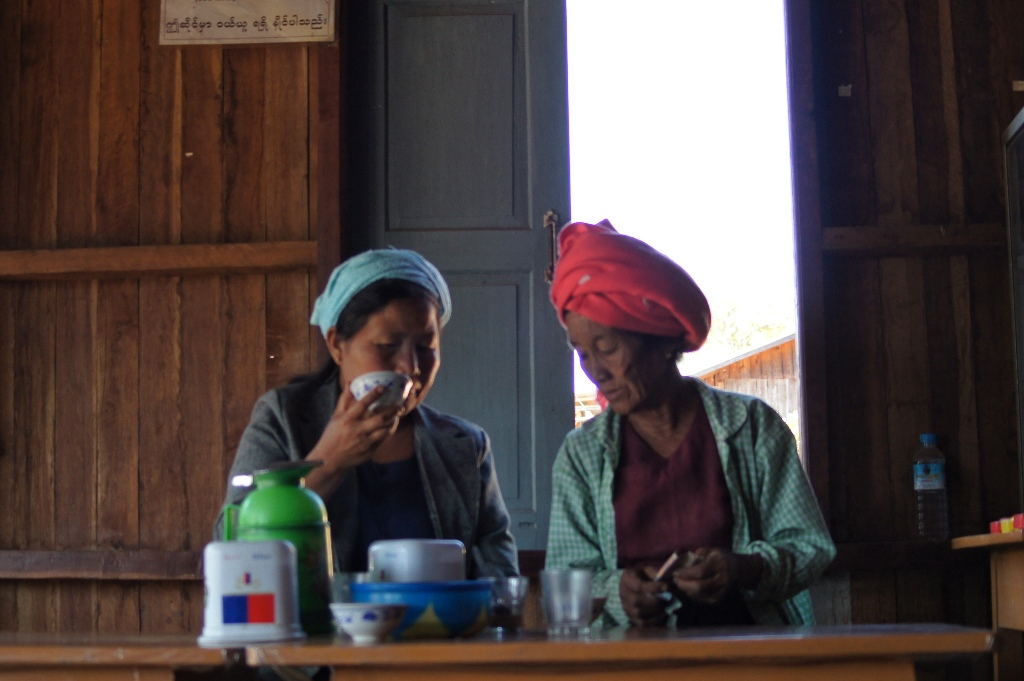 Two women enjoying tea in a tea shop on a train station