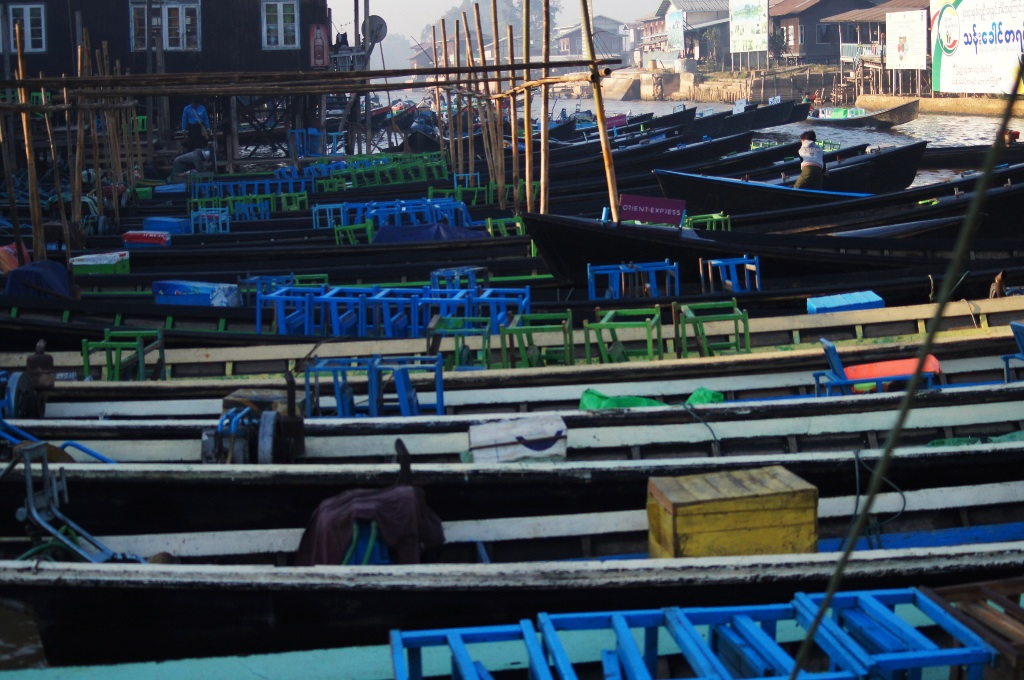 Boats waiting for customers in the wee hours  of the chilly morning in Nyangshwe.