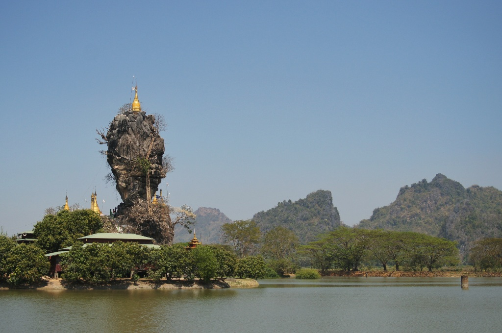 Kyauk Kalap, a beautiful pagoda on the rock in the center of an artificial lake.