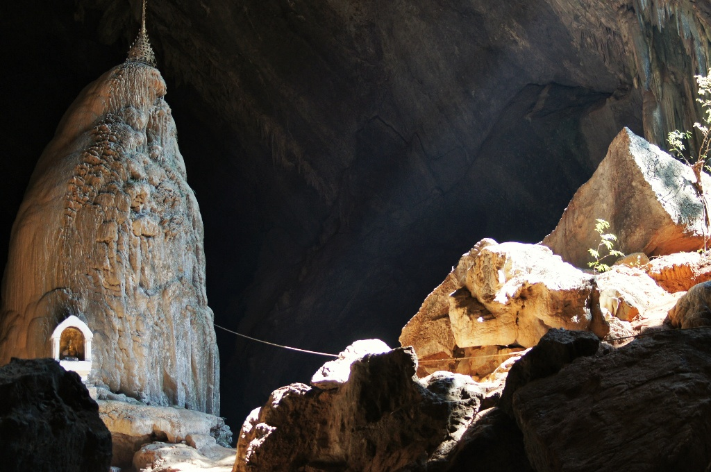 A sunlit Buddha image inside the cave.