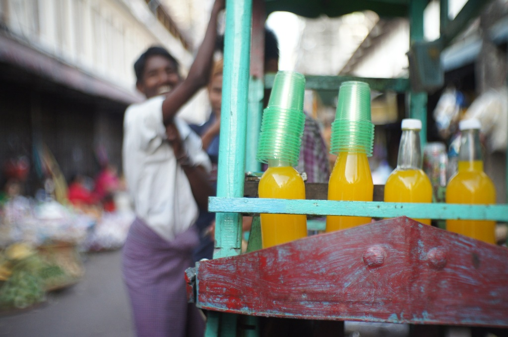 A happy orange juice hawker.